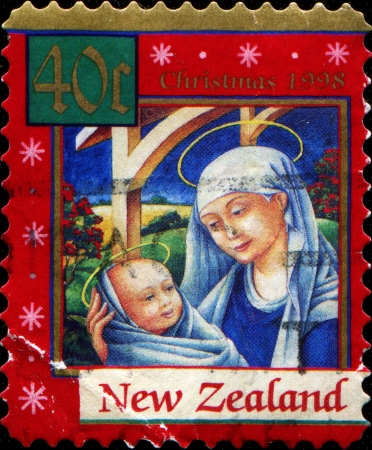 NEW ZEALAND - CIRCA 1998  A stamp printed in  New Zealand shows Christmas, Madonna and Child, circa 1998 Stock Photo - 14149628
