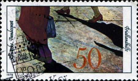 GERMANY - CIRCA 1978  A stamp printed in Federal Republic of Germany honoring 20th Anniversary of Friedland Aid Society, Refugees, circa 1978 photo