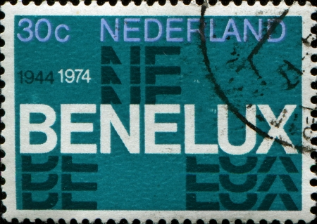 benelux: THE NETHERLANDS - CIRCA 1974  Postage stamp printed in Netherlands commemorating thirty years of the Benelux  economic union of Belgium, Netherlands, Luxembourg , circa 1974  Stock Photo