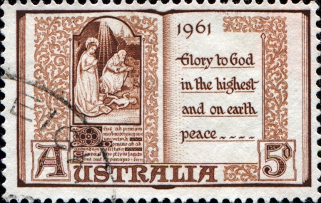 AUSTRALIA - CIRCA 1961  An Australian postage stamp shows The Holy Virgin Mary and baby Jesus, circa 1961  photo