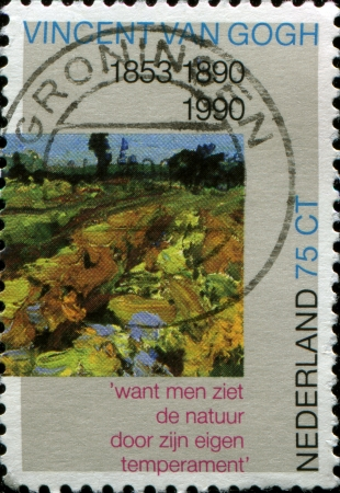 NETHERLANDS - CIRCA 1990  a stamp printed in the Netherlands shows paint by Vincent van Gogh - Green Vineyard  detail  , circa 1990 photo