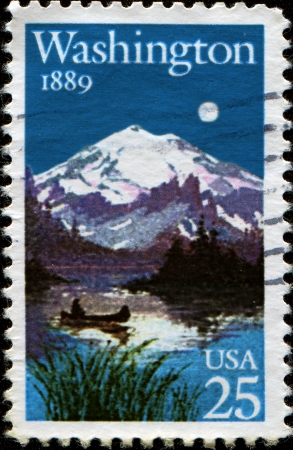 statehood: USA - CIRCA 1989  A Stamp printed in USA shows Landscape with Lake and Mount, Washington Statehood Centennial, circa 1989