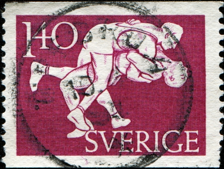 SWEDEN - CIRCA 1953  A stamp printed in Sweden honoring 50th Anniversary of Swedish Athletic  associacion, wrestling, circa 1953 photo