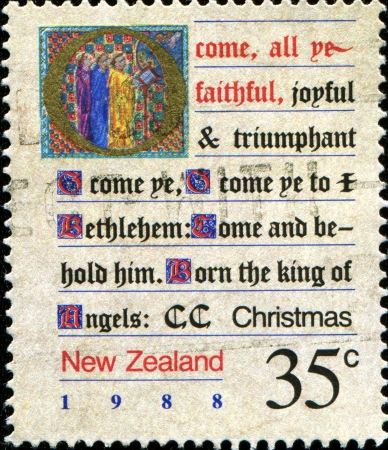 NEW ZEALAND - CIRCA 1988  A greeting Christmas stamp printed in New Zealand shows illuminated verses, O Come All Year Faithful , circa 1988