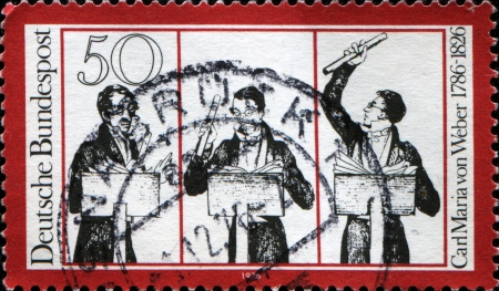 weber: GDR - CIRCA 1976  A stamp printed in German Democratic Republic  East Germany  honoring Carl Maria von Weber, shows musicians, circa 19776