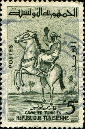 TUNISIA - CIRCA 1959  A stamp printed by Tunisia, shows Horseback Rider, circa 1959 photo