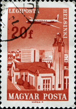 HUNGARY - CIRCA 1966  A stamp printed in  Hungary shows Plane over Helsinki, circa 1966  photo