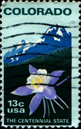 UNITED STATES OF AMERICA - CIRCA 1977   A stamp printed in USA honoring Centenary  1976  of Colorado Statehood shows Columbine  flower and Rocky Mountain, circa 1977  photo