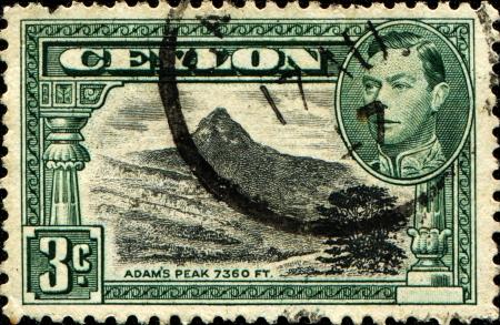 adams: CEYLON - CIRCA 1938  A stamp printed in the Ceylon shows Adam�s Peak, circa 1938