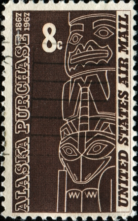 tlingit: UNITED STATES - CIRCA 1967  A stamp printed in the United States shows the Tlingit totem is from the Alaska state Museum, Juneau, Alaska Purchase Issue, circa 1967