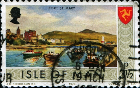 ISLE OF MAN - CIRCA 1973  A stamp printed in Isle of Man shows Port St Mary, circa 1973 photo