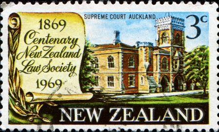 NEW ZEALAND - CIRCA 1969  A stamp printed in New Zealand honoring Centenary of New Zealand Law Society, shows Supreme Court Building, Auckland, circa 1969 photo