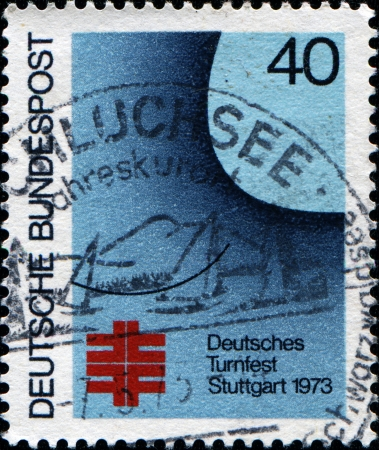 GERMANY - CIRCA 1973  A stamp printed in Federal Republic of Germany honoing Gymnastics Festival, Stuttgart, shows Gymnast  poster , circa 1973 photo