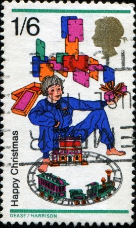 GREAT BRITAIN - CIRCA 1968  A stamp printed in Great Britain shows Boy with toy train and building blocks, circa 1968 Stock Photo - 14149553