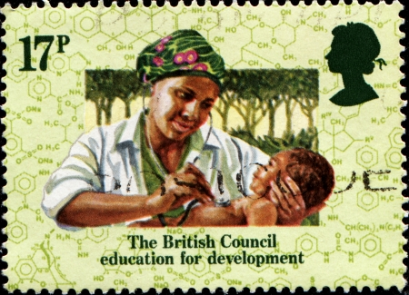 UNITED KINGDOM - CIRCA 1984  A stamp printed in United Kingdom issued for the 50th anniversary of British Council education for development shows nurse with child, circa 1984
