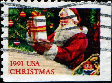 UNITED STATES - CIRCA 1991  A stamp printed by United States shows Santa Claus with present, circa 1991  photo