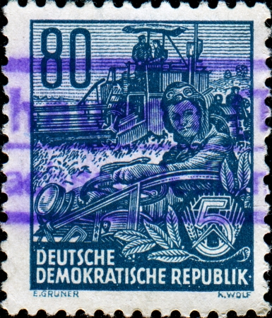 GDR - CIRCA 1953  A stamp printed in GDR  German Democratic Republic - East Germany  shows woman tractor driver, from the series  Workers For The Five-year Plan , circa 1953
