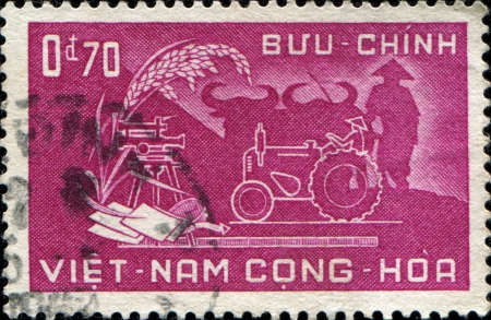 SOUTH VIETNAM - CIRCA 1958  A stamp printed in South Vietnam honoring Agricultural Reform, circa 1958 photo