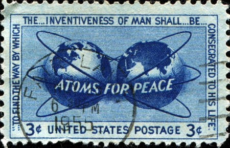 encircling: USA - CIRCA 1955  A stamp printed in USA shows the Atomic Energy Encircling the Hemispheres, Atoms for Peace Policy, circa 1955  Stock Photo