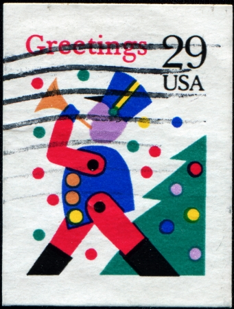 UNITED STATES OF AMERICA - CIRCA 1993  A stamp printed in the USA shows Toy soldier with horn, circa 1993 Stock Photo - 14184392