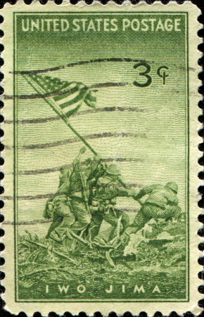 USA - CIRCA 1945  A stamp printed by USA shows the raising of the flag on My Surabachi on Iwo Jima during WWII, circa 1945 Stock Photo - 14184844