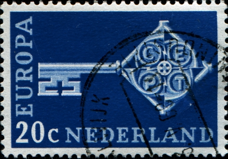 NETHERLANDS  - CIRCA 1968  A stamp printed in Netherkands shows a cross-shaped key, and CEPT emblem on the neck, circa 1968  Stock Photo - 14184394