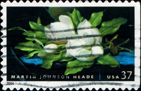 postal stamp: UNITED STATES OF AMERICA - 2004  A stamp printed in the United States of America shows  painting by Martin Johnson Heade - Giant Magnolias on a Blue Velvet Cloth, 1890, American Treasures series, 2004