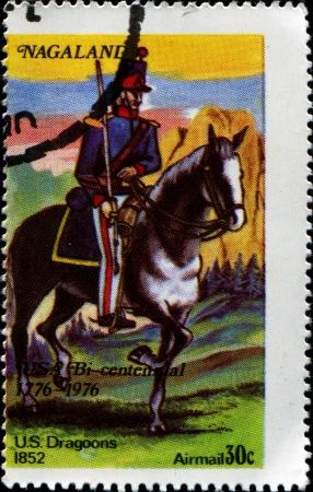 dragoon: USA -CIRCA 1976  A stamp printed in USA shows dragoon on a horse, Circa 1976