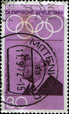 GERMANY - CIRCA 1968  A stamp printed in the Germany, dedicated to the 19th Olympic Games, Mexico City, shows the Pierre de Coubertin, circa 1968  Stock Photo - 14175118