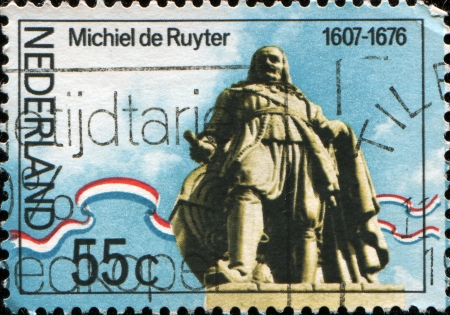 bygone days: THE NETHERLANDS - CIRCA 1976  A stamp printed in  Netherlands shows statue ofAdmiral Michiel Adrianszoon De Ruyter over the sea in Flushing, circa 1976 Editorial