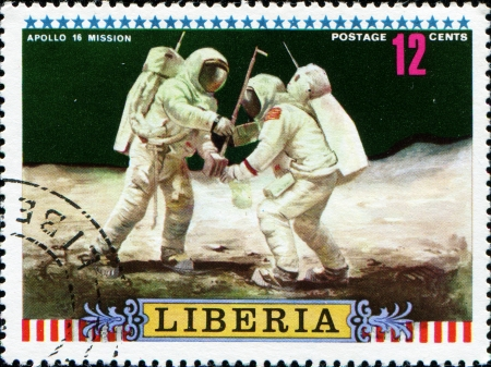 LIBERIA - CIRCA 1972  A post stamp printed Liberia shows Moon Mission of Apollo 16 Setting up equipment , circa 1972  photo
