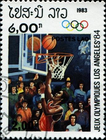 LAOS - CIRCA 1983  A stamp printed in Laos shows basketball, circa 1983