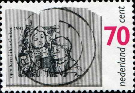 NETHERLANDS - CIRCA 1991  A stamp printed in Netherlands honoring Centenary  1992  of Public Libraries in the Netherlands, Children and Open Book, circa 1991  photo