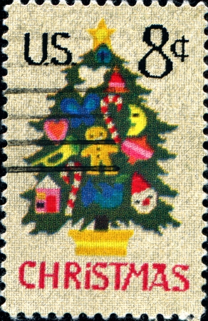 UNITED STATES - CIRCA 1973  A stamp printed in the United States shows Christmas Tree in Needlepoint, circa 1973  photo