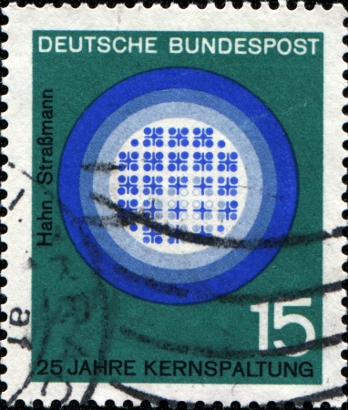 treatise: GERMANY - CIRCA 1964  A stamp printed in German Federal Republic honoring  Scientific Anniversaries, shows Diagram of nuclear reaction, 25th anniversary of publication of Hahn-Strassman treatise on splitting the nucleus of the atom, circa 1964 Stock Photo