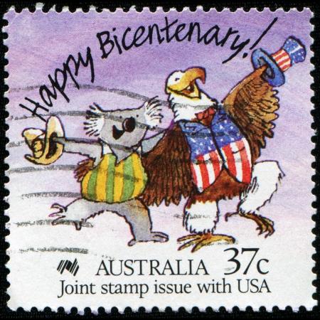 AUSTRALIA - CIRCA 1988  A stamp printed in Australia shows Happy Bicentenary  Caricature of Australian Koala and American Bald Eagle, circa 1988  photo