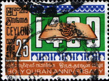 CEYLON - CIRCA 1968  A stamp printed in Ceylon honoring 1400th Anniversary of Koran, shows Open Koran, circa 1968  photo