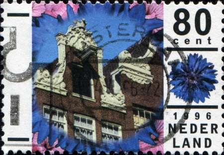 NETHERLANDS - CIRCA 1996  A stamp printed in Netherlands shows Traditional architecture, Amsterdam, circa 1996 photo