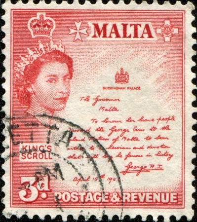 MALTA - CIRCA 1956  A stamp printed in Malta shows Queen Elizabeth II, King  Stock Photo - 14200666