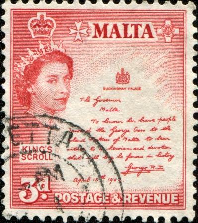 MALTA - CIRCA 1956  A stamp printed in Malta shows Queen Elizabeth II, King  Stock Photo - 14200666