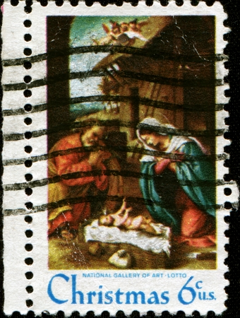 USA - CIRCA 1970  A stamp printed in the USA, shows the  Adoration of the Child  by Lorenzo Lotto, circa 1970  photo