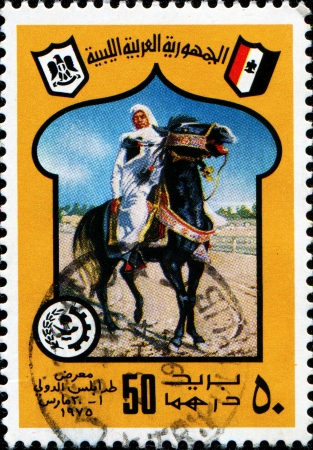 LIBYA - CIRCA 1975  A stamp prinetd in Libya shows man on horse, circa 1975