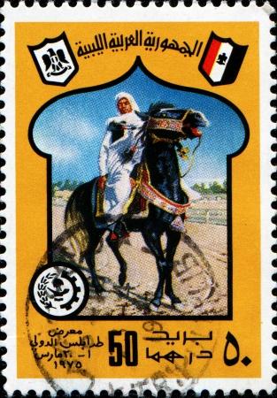LIBYA - CIRCA 1975  A stamp prinetd in Libya shows man on horse, circa 1975