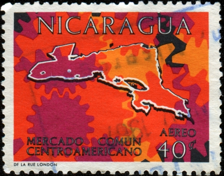 NICARAGUA - CIRCA 1964  A stamp printed in Nicaragua shows Central American, Common Market,  Cogwheels Air, circa 1964 Stock Photo - 14198121
