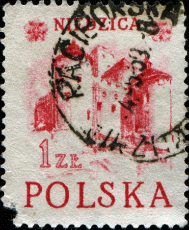 POLAND-CIRCA 1952 A stamp printed in Poland shows Niedzica Castle also known as Dunajec Castle is located in the southernmost part of Poland in Niedzica, circa 1952 Stock Photo - 14198592