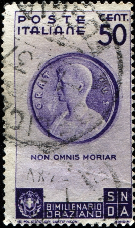 horace: ITALY - CIRCA 1936  A stamp prined in Italy shows Medallion with Horace  Museo di Cracovia , inscript  Non omnis morinar - I shall not altogether die, circa 1936