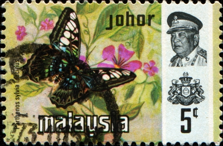 MALAYSIA - CIRCA 1971  A stamp printed in Johor Inset portrait of Sultan Ismail, shows butterfly Clipper - Parthenos sylvia lilacinus, circa 1971