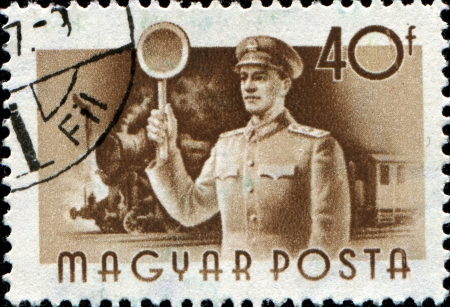 HUNGARY - CIRCA 1955  A stamp printed in Hungary shows Railwayman and train, series, circa 1955