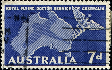 AUSTRALIA - CIRCA 1957  A stamp printed in Australia, is dedicated to Royal Flying Doctor Service of Australia, shows the Caduceus and Map of Australia, circa 1957  photo