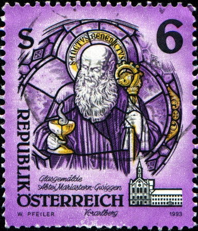 abbeys: AUSTRIA - CIRCA 1993  A stamp printed in Austria shows St  Benedict of Nursia  glass painting , Mariastern Abbey, Gwiggen, Monasteries and Abbeys series, circa 1993  Stock Photo